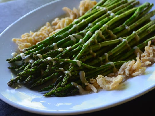 Horseradish Kissed Asparagus are garnished with French's