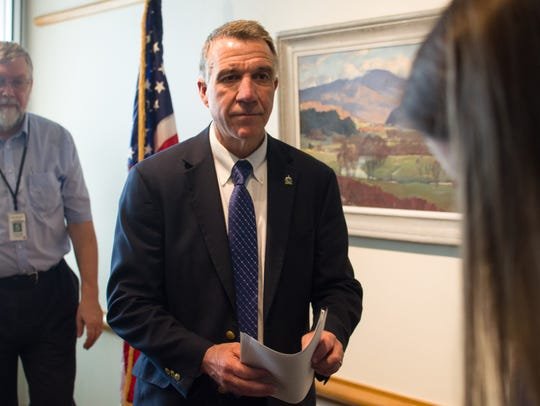 Gov. Phil Scott leaves a Montpelier news conference