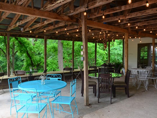 The patio has an eclectic mix of tables and is a great