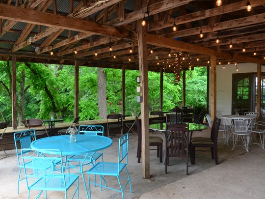 The patio has an eclectic mix of tables and is a great spot to enjoy a glass of lavender Prosecco.