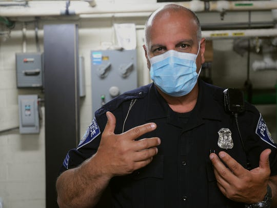 Port Huron Police Sgt. Dave Seghi models the face mask that officers must wear when collecting fentanyl and other drugs as evidence. He said fentanyl is very fine and can be ingested when airborne unintentionally, it can also be absorbed through pores as well.