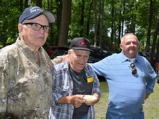 Three miners who worked the Cornwall Mines, from left, Phil Showers, Time Wolfe, and Bernie Showers, reminisce at this past Saturday's 35th annual Cornwall Miners Picnic held at Lion's Park in Rexmont.
