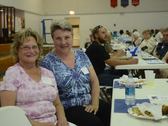 Lou Ann Andrews, left, now of Port Huron Township, and Peggy Gregg, of St. Clair Township, have been best friends since they went to Trinity Lutheran 1966 through 1974. They sat and ate with each other during Sunday's farewell event in the school's gym.