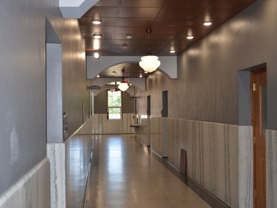 Hallways at the newly renovated courthouse feature LED lighting and restored marble trim.