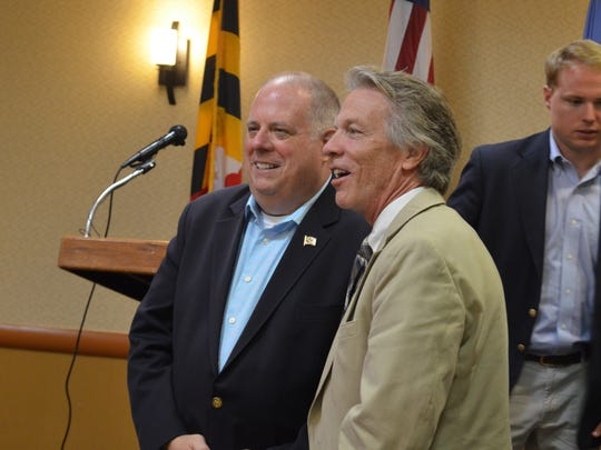 Maryland Gov. Larry Hogan (left) talks with John Cannon,