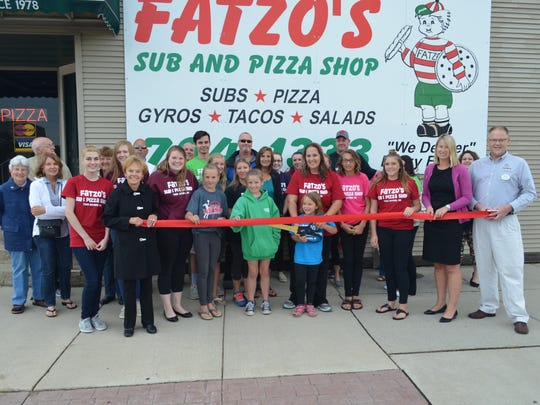 Assisting owners Jessica Crowe and Adam Panosh with the ribbon-cutting were Fatzo's Sub & Pizza Shop employees and family members, and members of The Chamber of Manitowoc County's Board of Directors and Chamber Ambassadors.