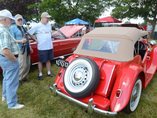 Dave Sickles, left, talks about his 1953 MG TD sports