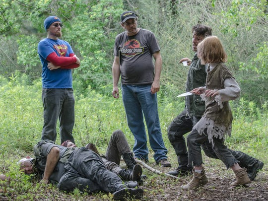 """Fight coordinator Desso Faulkner, from left, and director Stephen Wise run through a scene with Chris Kubiak and Gabrille Faulkner, standing, and Jason Robbins and Anna Faulkner, on the ground, on the set of """"Sur'vi."""""""