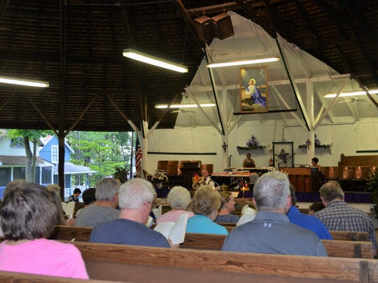 Rev. Dr. Jerry Zweitzig conducts the hymn sing during an evening's service at the 125th Mt. Lebanon Campmeeting in 2017.