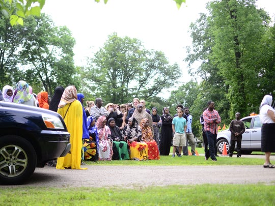 Mourners for 11-year-old Ali Muhima gathered at Lakeview Cemetery on Saturday, July 15, 2017.