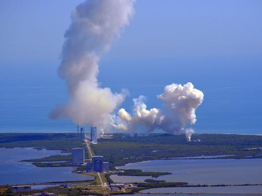 A rocket launch at the Kennedy Space Center is shown