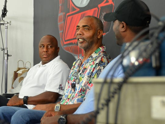 Reds Hall of Famer Dave Parker chats with third base coach Billy Hatcher and Corey Hawthorne, Reds director of player relations.