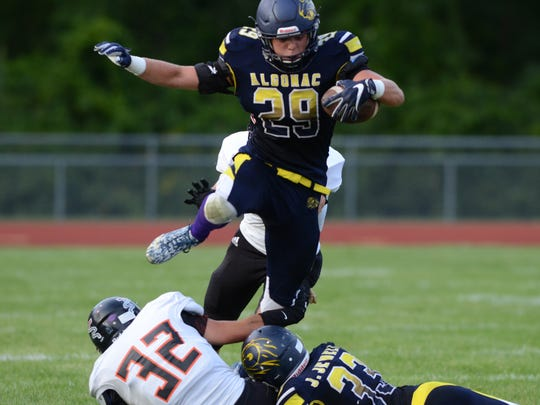 Algonac running back Luke Stephenson jumps over players while running the ball for a first down against Marine City Aug. 24.