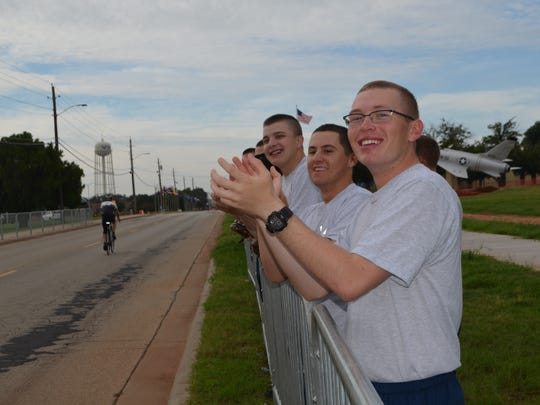 Airmens' Alley features dozens of airmen in training from each of the training squadrons at Sheppard Air Force Base cheering loudly and giving high-fives to passing cyclists during the Hotter'N Hell ride Saturday morning.