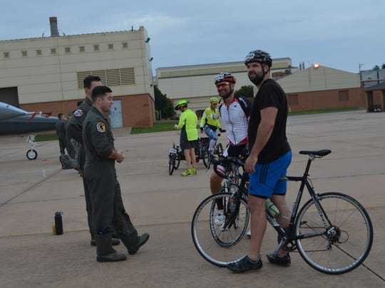 Sheppard Air Force Base pilots talk with Hotter'N Hell cyclists Saturday morning on the base at Air Power Alley.