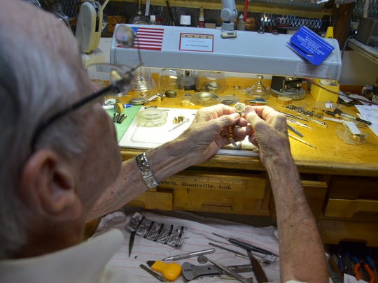 Ralph Hutchinson sets the time on a watch he recently repaired at Hutchinson Jewelers in Boonville, Indiana.