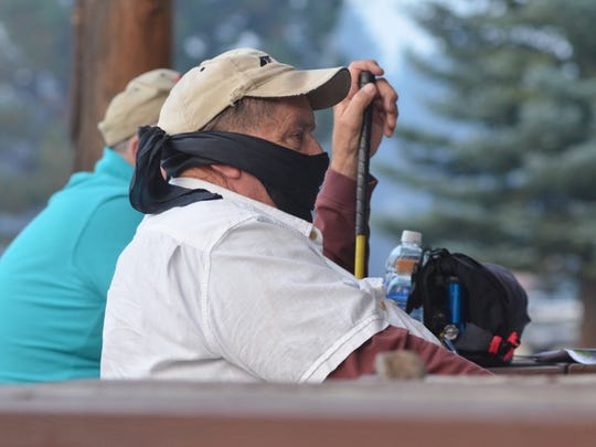 One man wore a face mask over his oxygen tubes to the community fire meeting in Lincoln on Sept. 5.
