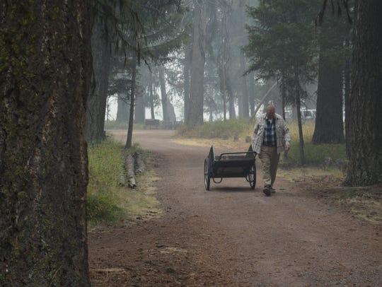 David Davis takes a cart to retrieve some items from