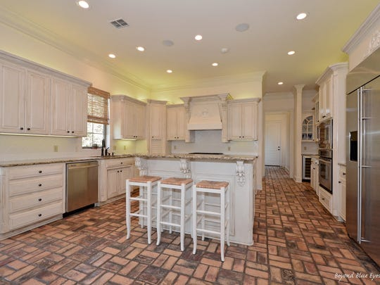 The kitchen at 10860 Belle Cour Way.