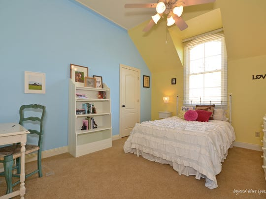 This $575,000 home features five bedrooms and five