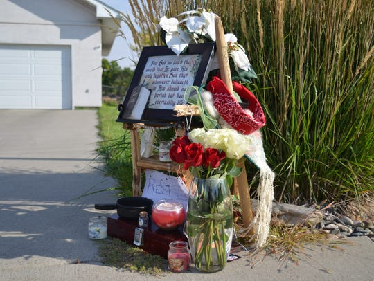 The memorial set up at the scene where a man was shot