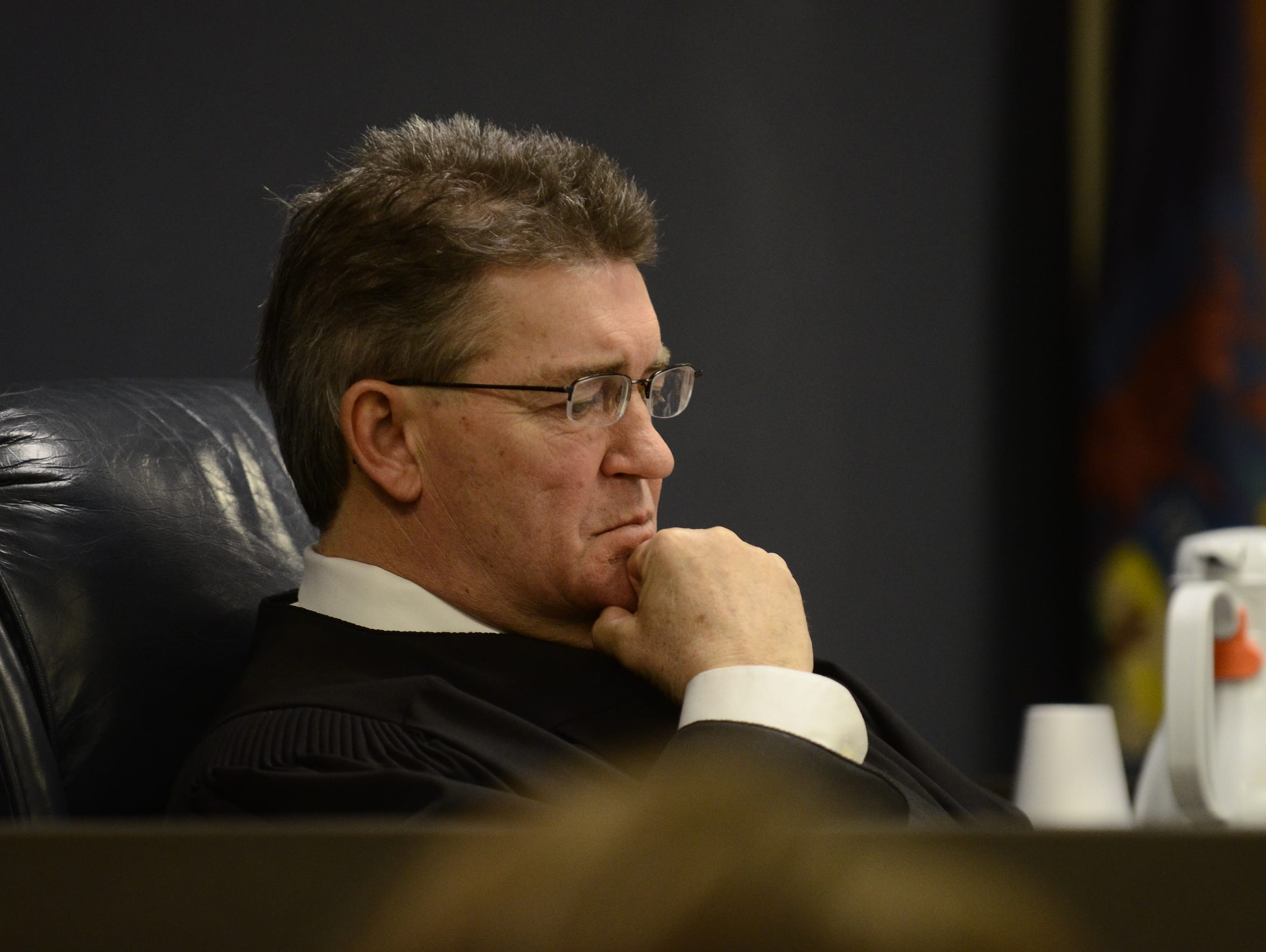 Judge Michael West listens to arguments over the sentencing