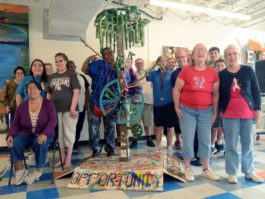 "The group that helped build ""Accessible Dreams"" poses with their art piece. It will be on display at ArtPrize in Grand Rapids Sept. 20-Oct. 8."