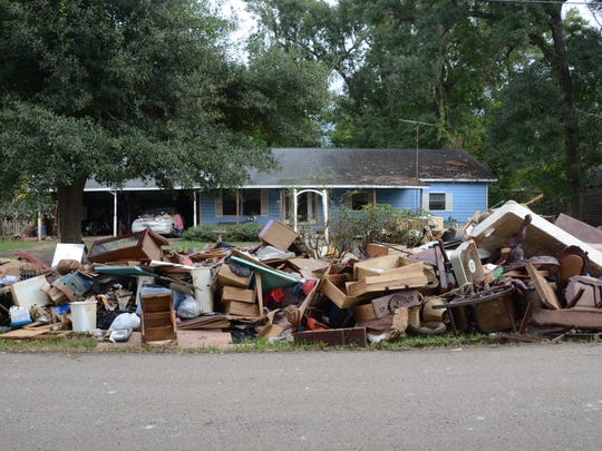 Flood-soaked debris is piled outside homes in Rose City, Texas, near Beaumont, on Monday, Sept. 18, 2017, three weeks after Hurricane Harvey hit.