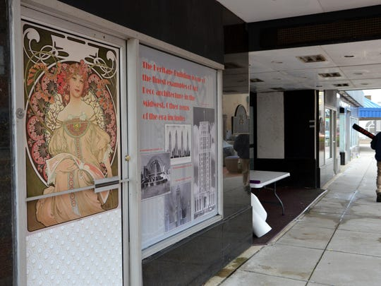 The graphics were installed on the first floor windows of Heritage Tower facing Michigan Avenue on Friday morning.