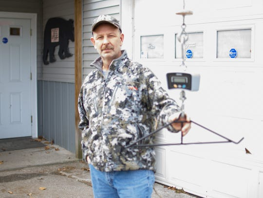 Mike Fontaine, owner of M & R Guns and Ammo in Highgate