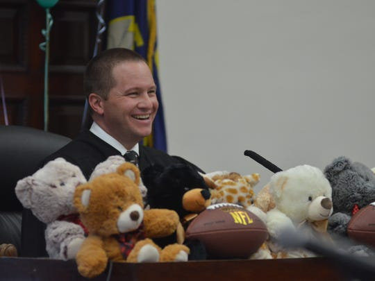 District Judge Greg Pinski had an assortment of stuffed animals and footballs ready for children ahead of the adoption ceremony on Monday, Nov. 20.