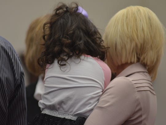 Children from ages 17 to only a few years were brought into new families at the adoption ceremony on Monday.