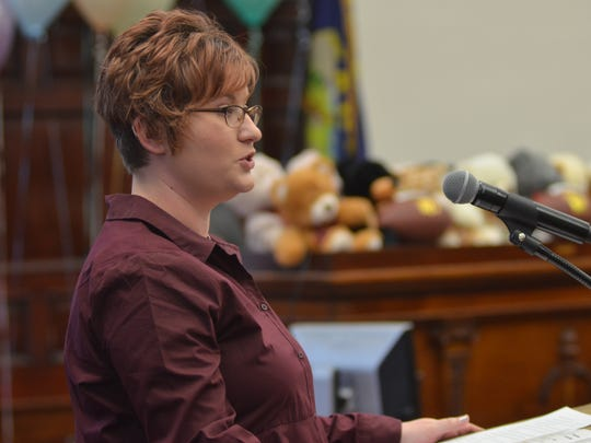 Lizette Hofer, a resource family specialist, MC'd the adoption ceremony on Monday at the Cascade County courthouse.