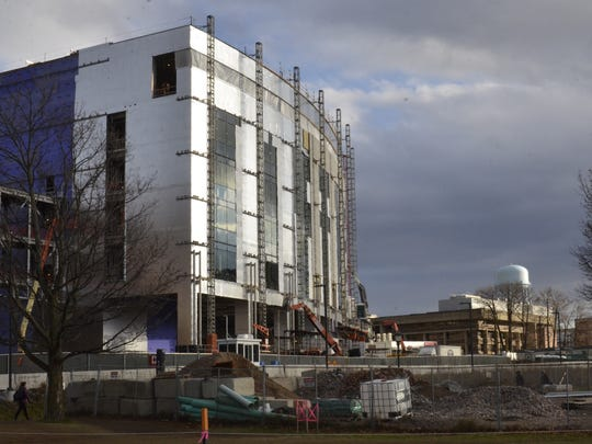At the University of Vermont on Wednesday, Dec. 6, 2017, students walked around a maze of construction as a new STEM facilities building is constructed.