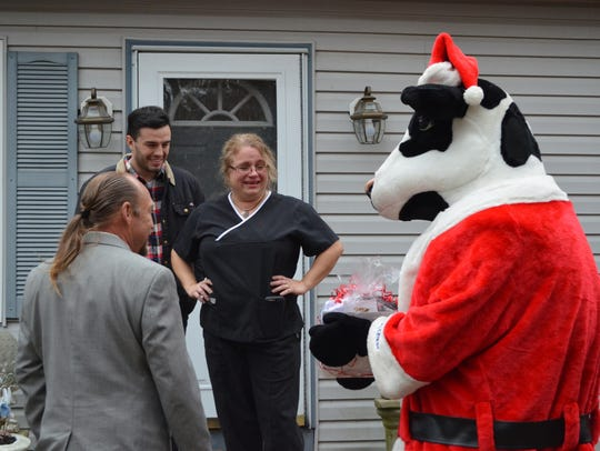 The cow from Chick-Fil-A in Egg Harbor Township presents