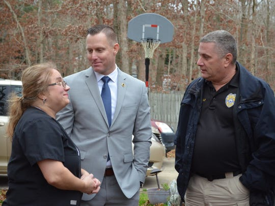 Jodi Algeri talks to Lt. Jeff Lancaster, vice president of the Mainland PBA, and Ray Theriault, president of the Mainland PBA. The family of the late Lt. David Algeri, who retired from the Egg Harbor Township Police Department, was nominated for the roof giveaway by the Mainland PBA. Photo/Jodi Streahle