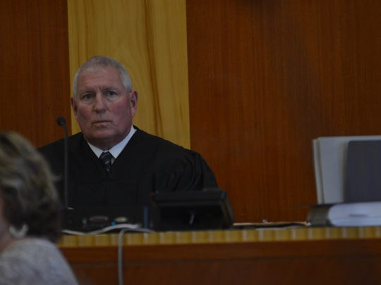 Judge John Oldenburg hears arguments on the sufficiency