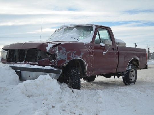 A damaged pickup pushed into a snowbank on Wednesday