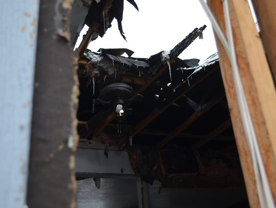 The living room is exposed where a chimney fire destroyed