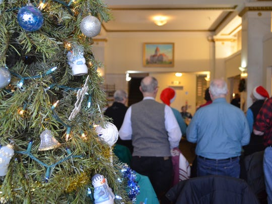 Folks sang Christmas songs and church hymns for nearly