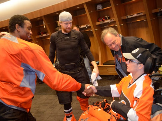 Three years ago Jackie Lithgow met the Flyers as he was rehabbing his traumatic brain injury.