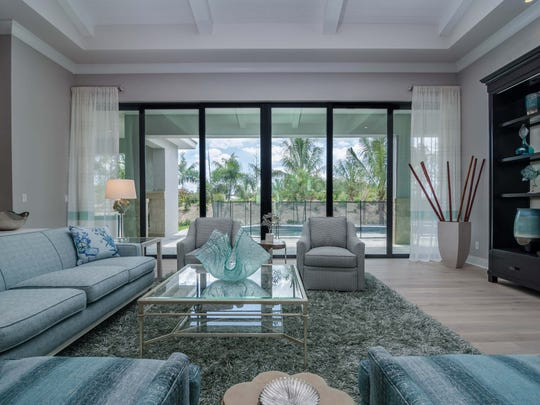 The living area in Marvin Development's Captiva model in Parrot Cay at Naples Reserve.