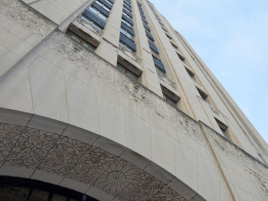 Perched along the large lower windows of Heritage Tower,
