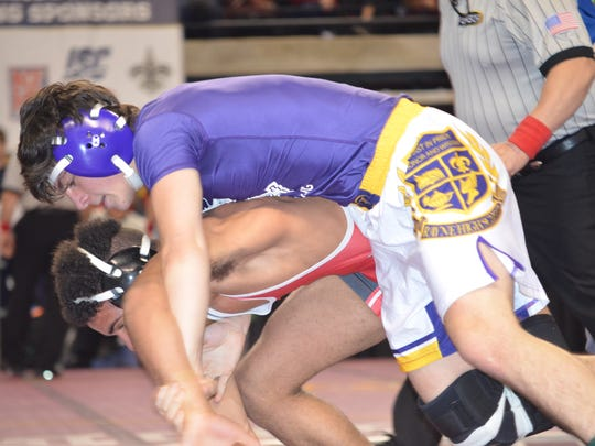 Rayne's Cooper Simon, top, reaches the finals at 120 pounds at the Division II State Wrestling Tournament on Saturday in Bossier City.