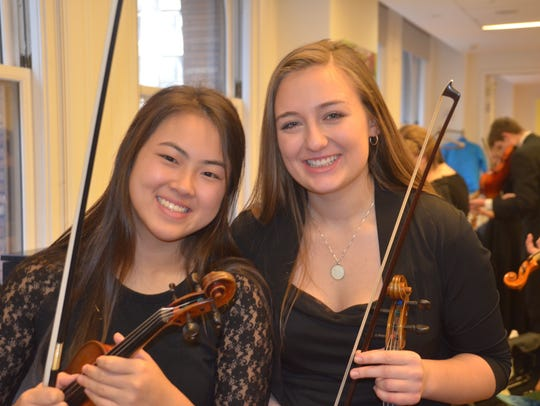 Seniors Rachel Fu of Homestead High School and Natalia Sorbjan of Shorewood High School, co-concertmasters, pose for a picture right before the performance.