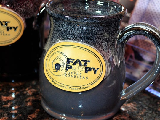 "The Fat Puppy logo ""speaks"" to the roaster's iconic"