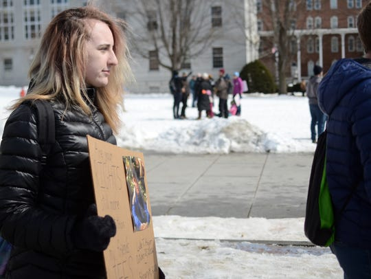 Amber DeFord, 15, of Hartford, carried a photo of Luke