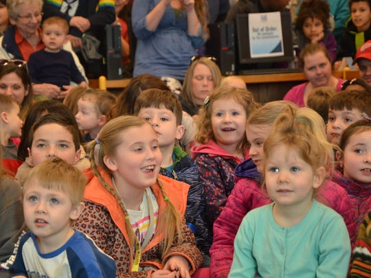 Children listen to the presentation at Willard Library as part of the Zoomobile program on Thursday, April 5, 2018.