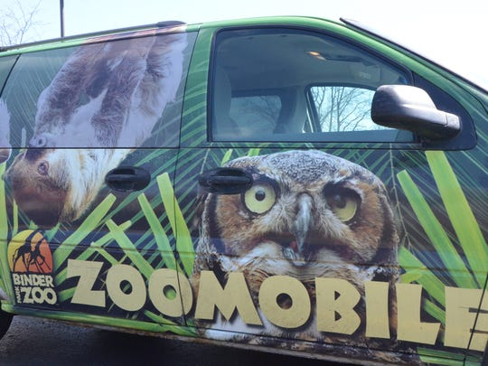 The Binder Park Zoomobile sits parked outside of Willard Library on Thursday, April 5, 2018.