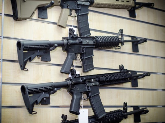 Gun wall rack with rifles